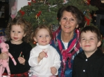 this is a photo of myself and three of my eight great grandchildren, devn, lilly and brandn. devn and brandn are brother